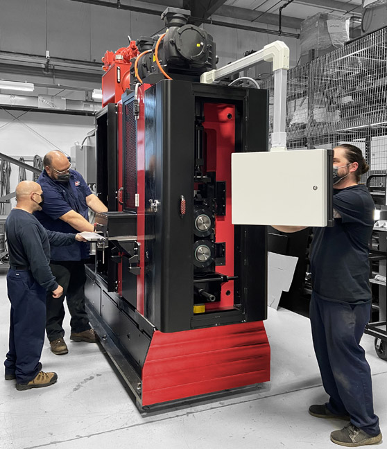 Workers on a FENN Torin Machine