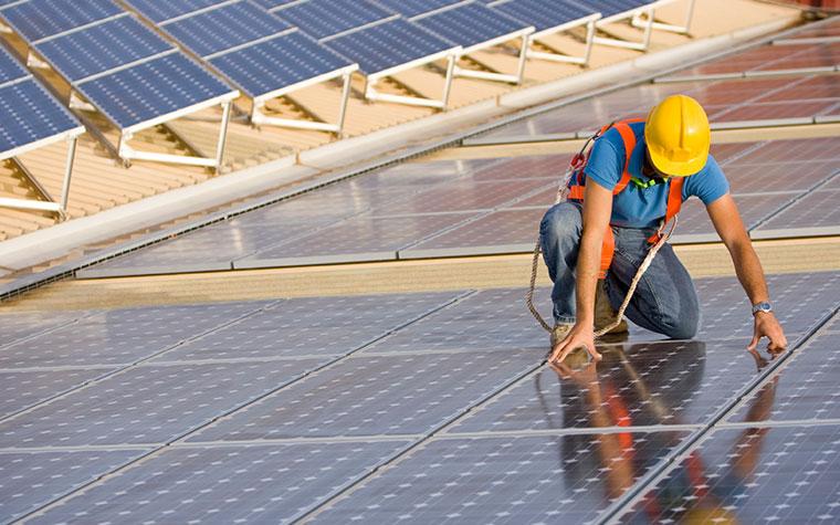 Man Placing Solar Panels Down